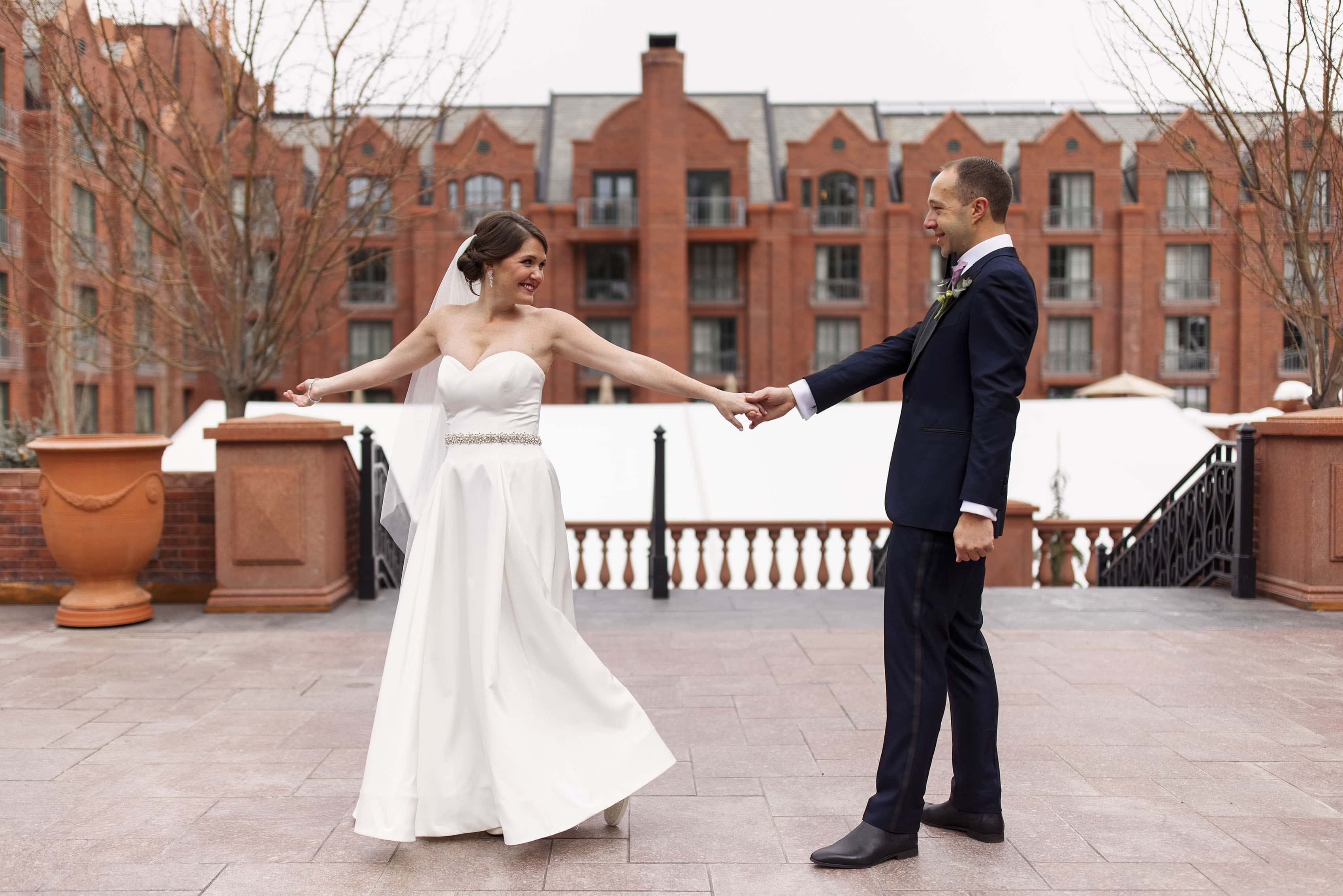 Olivia twirls for Kyle during their first look at The St. Regis in Aspen on their wedding day