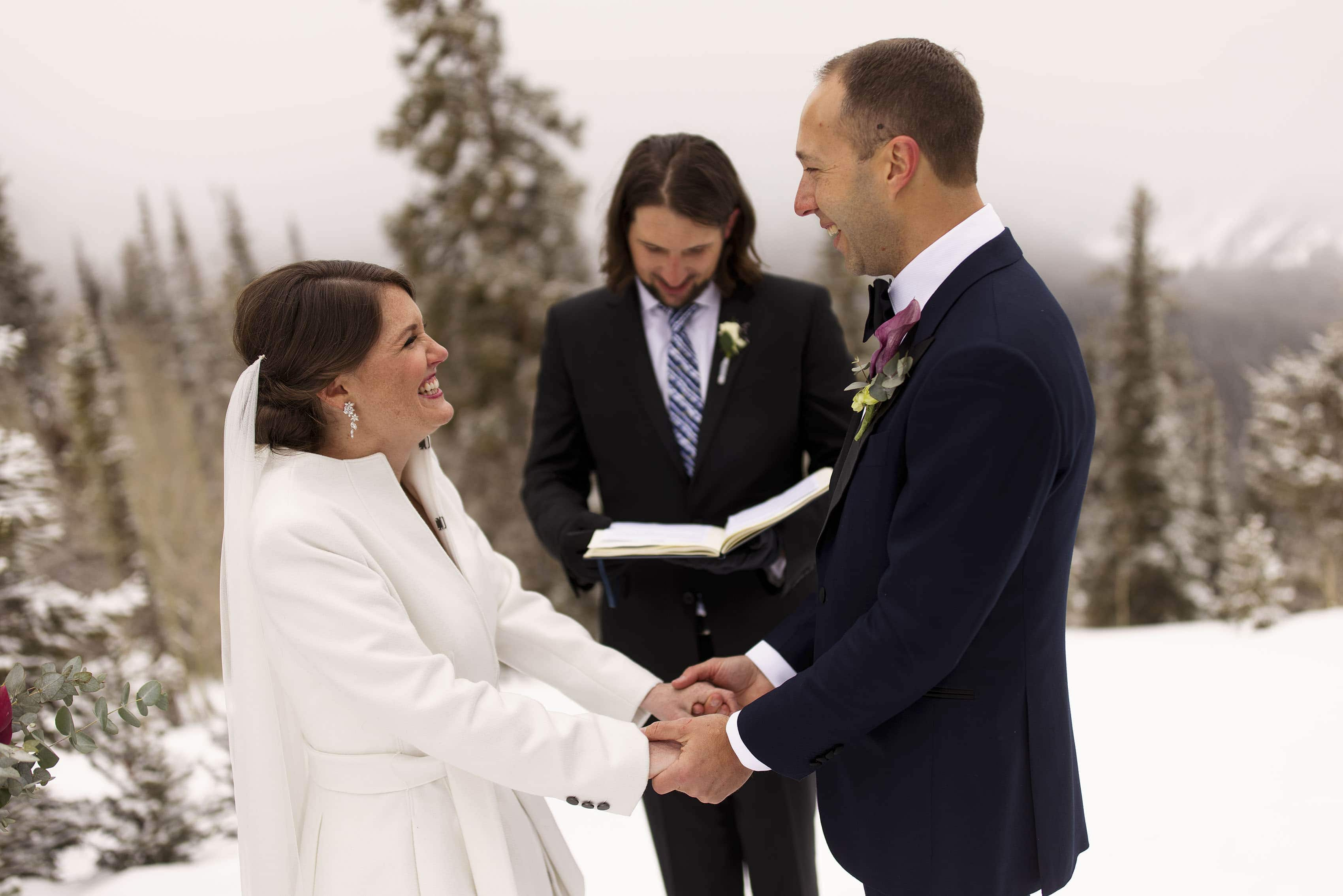 The bride and groom share a laugh on the wedding deck during their Aspen micro wedding