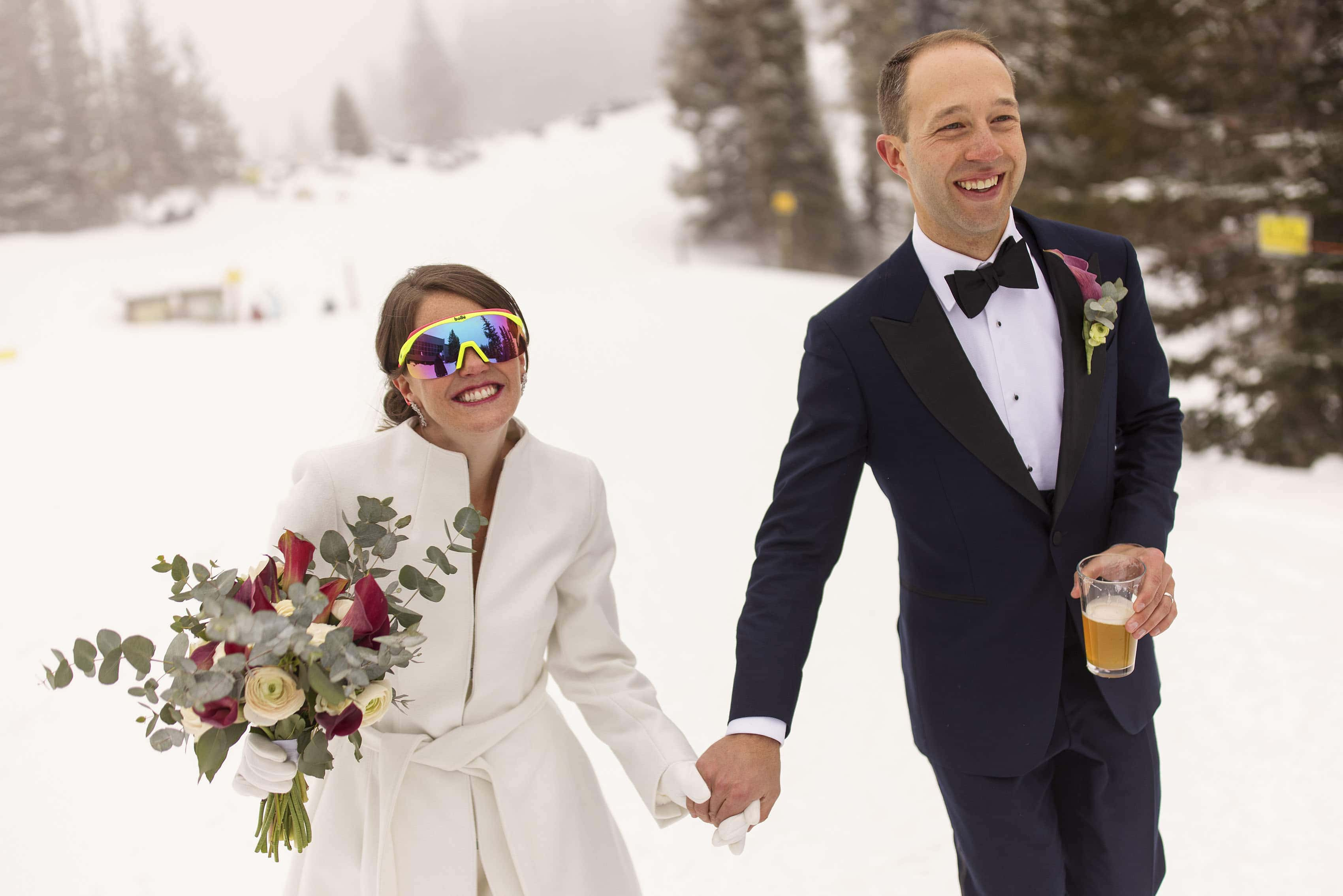 Olivia sports retro sunglasses as Kyle enjoys a beer after their wedding ceremony in Aspen